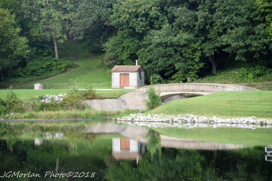 Springbrook State Park bridge and bathhouse on a calm day.