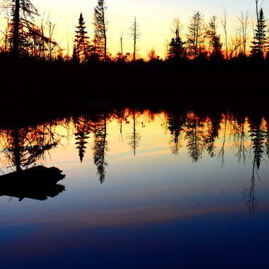 Last light over beaver pond on a still evening Nikon 3400 35mm lens vivid