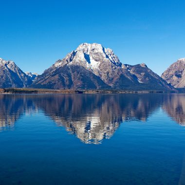 Mount Moran reflected in Jackson Lake in Grand Teton National Park.