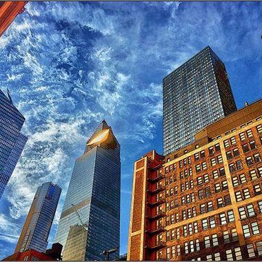 #alovelyday #intheneighborhood #blueskys #redbuildings  #bluebuildings #newskyscrapers #tlwheatman
