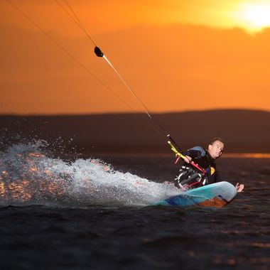 "Thierry Schmitter is a kitesurfer who's not stopped by sitting in a wheelchair, his skills are impressive! He straps himself to a seat mounted to his kiteboard (""sit-kite""). We attached a flash to the lines for an evening session on the water in the ""Zandmotor"", The Hague, the Netherlands. It was fun, we only stopped when it was too dark to focus the camera."