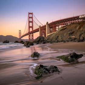 The wonderful Golden Gate bridge in San Francisco stands tall from all over the bay, but the pearlescent reflections from the beach are probably ...