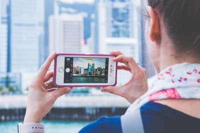Women Capturing Travel Photo with iPhone