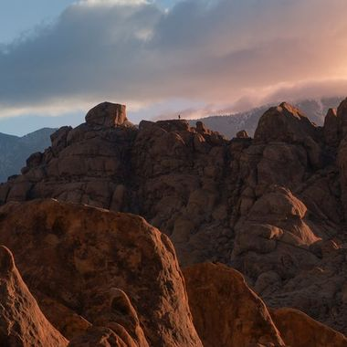 On our road trip up Hwy 395 we stopped at Alabama Hills for the night. Of course the next morning I woke early to take advantage of the morning light on the hills. I took this this shot of early light and a lone hiker up on the second row of rocks ( not to noticeable ) I wanted to show the depth and scale of the landscape.