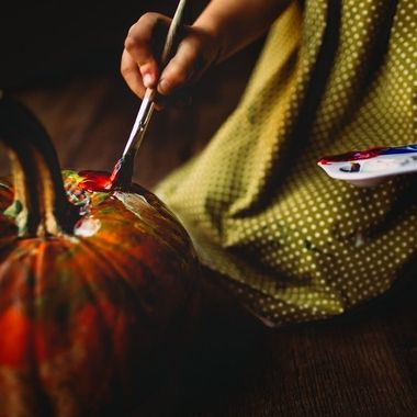My daughter choosing the most beautiful colors to paint her pumpkin.