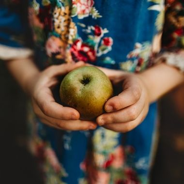 My daughter found a lovely green apple while at the orchard the other day, it complimented the colors of her dress so well I had to take a picture.
