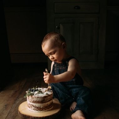 My son eating a delicious birthday cake.  I would know because I ate the 3/4's he didn't eat lol.