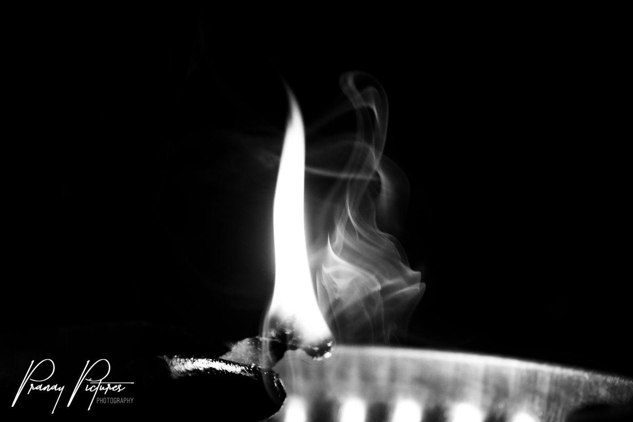 Flame dancing with smoke