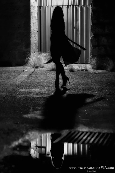 Silhouette by a Street Light