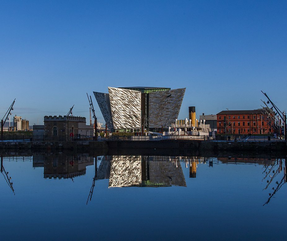 The Titanic Quarter, Belfast Northern Ireland is reflected in the docks.