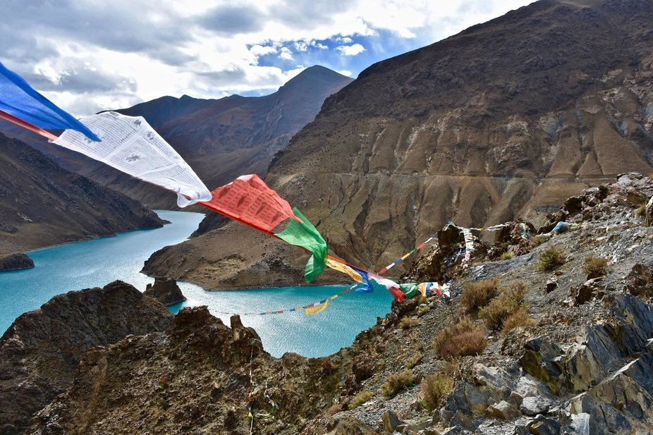 The natives hang prayer flags in the most amazing dangerous places.    When the wind rose they so...