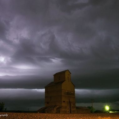 Lightning storm and grain elevator