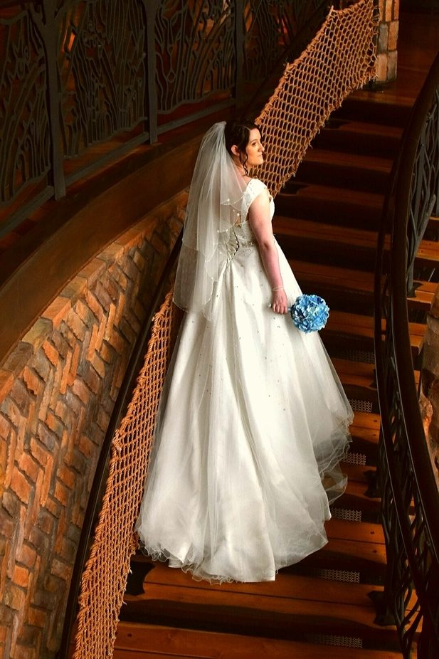 Kelly on stairs at Disney's Animal Kingdom lodge, Jambo house.