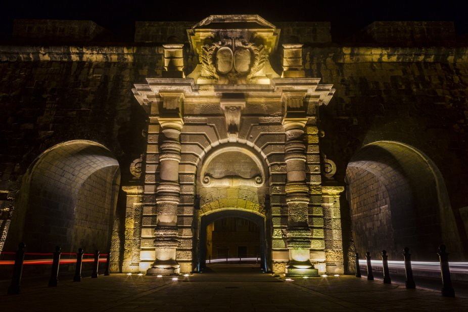 Saint Helen's Gate, at Cospicua, Malta by night with car lights trails