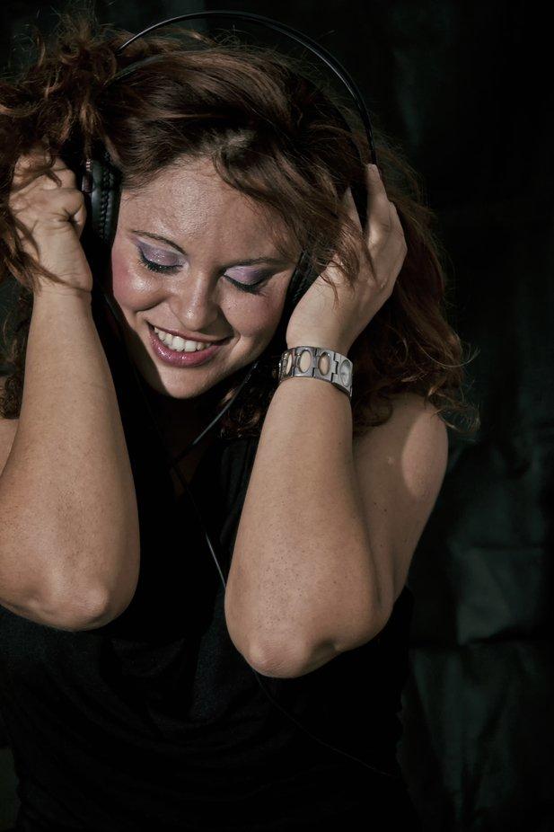 Girl listening music with earphones