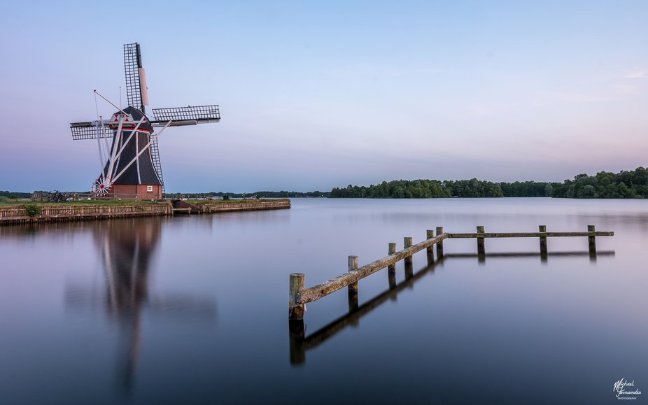 This was a shot at sunset of a windmill that overlooks Petersworld Lake in Groningen, Netherlands.