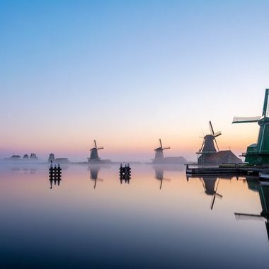 This is a shot at sunrise at Zaanse Schans. The fog was covering up the whole entire landscape but as the sun started to rise, the fog pulled back and revealed this.