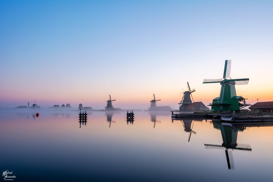 This is a shot at sunrise at Zaanse Schans. The fog was covering up the whole entire landscape bu...