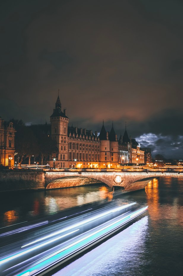 Tour boat on the river Seine. by valentinfranois - Bright City Lights Photo Contest