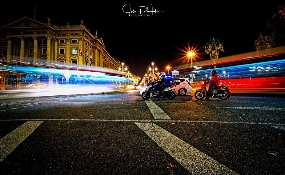 Traffic moving around Columbo Circle and La Rambla, Barcelona, Catalonia