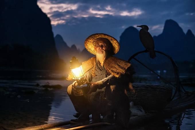 The cormorant fishermen by carmenioneanu - Night Wonders Photo Contest
