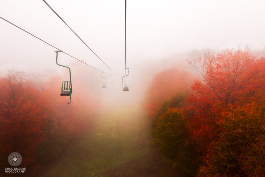 The iconic Mad River Glen single chair shrouded in the fog.
