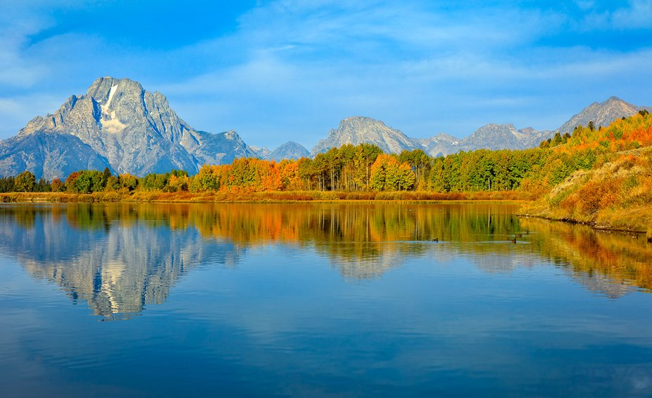 View of Mount Morand and other mountains in the Grand Tetons along with a reflection taken from O...