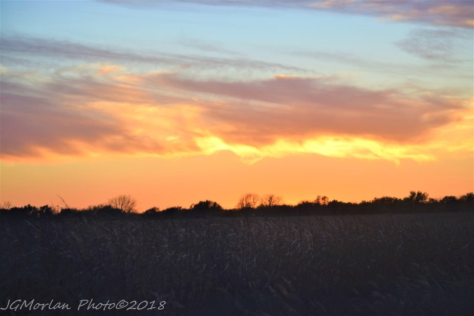 Sun setting behind clouds