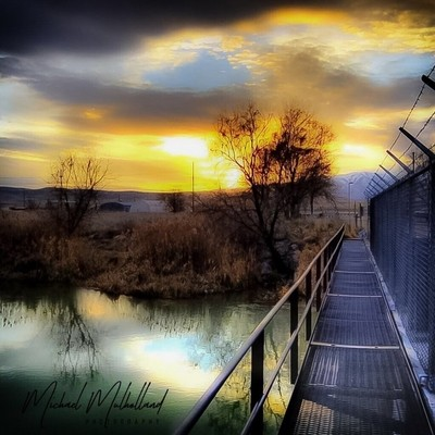 Clouds & Sunlight on a fenced bridge over river captured by canon 5D mkIII Canon Pro series lenses
