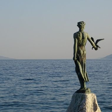 Statue of Lady with a seagull in Opatija, Croatia