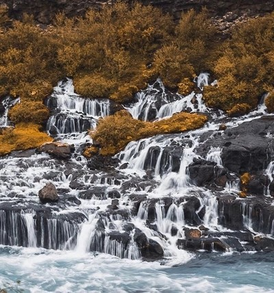 WATERFALLS OF HRAUNFOSSAR ???????? . Here we were exploring the west Icelandic nature and went to magnificent Hraunfossar waterfalls. The waterfalls of Hraunfossar are a real treasure. It´s best described as a collection of countless creeks and cascades s