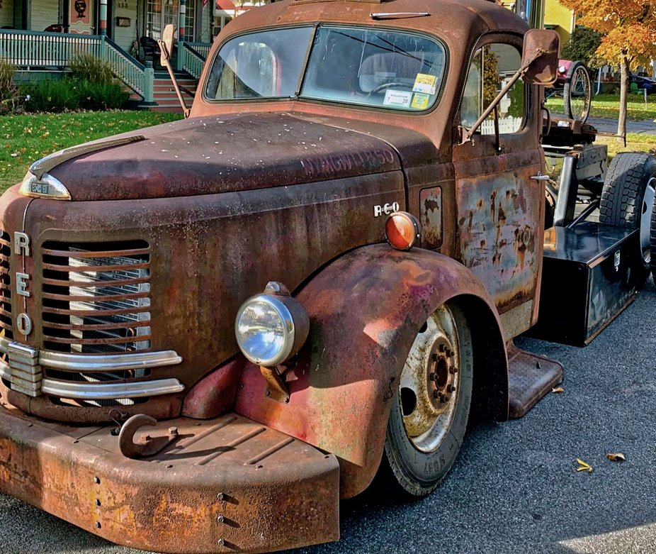 Rusty old REO tow truck cab seen on the side of a street in Saugerties NY.
