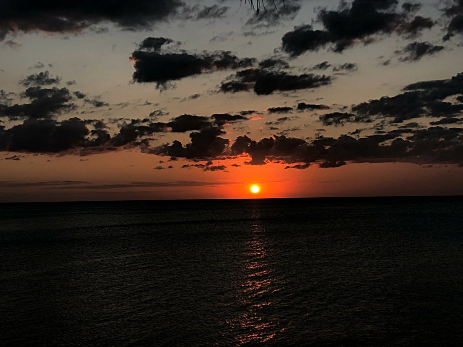 The sun is the only light which shines through the darkness overcoming the sea