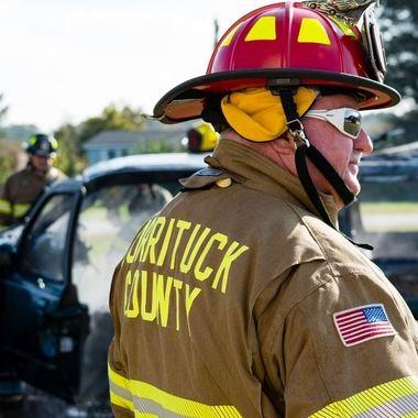 Volunteer firemen train on vehicle fires.