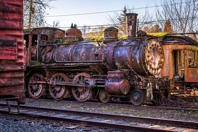 rusty train on the tracks