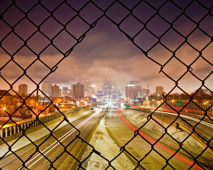 Downtown Minneapolis through a hole in a pedestrian bridge. by stevestenzel - Bright City Lights Photo Contest