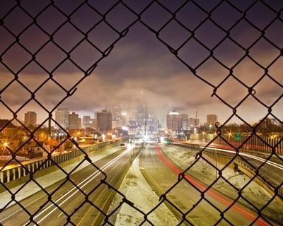 Downtown Minneapolis through a hole in a pedestrian bridge.