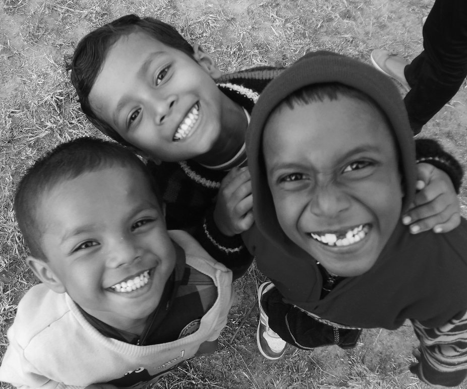 The photograph taken in rural Jharkhand state in India. The naughty kids posed for the click duri...