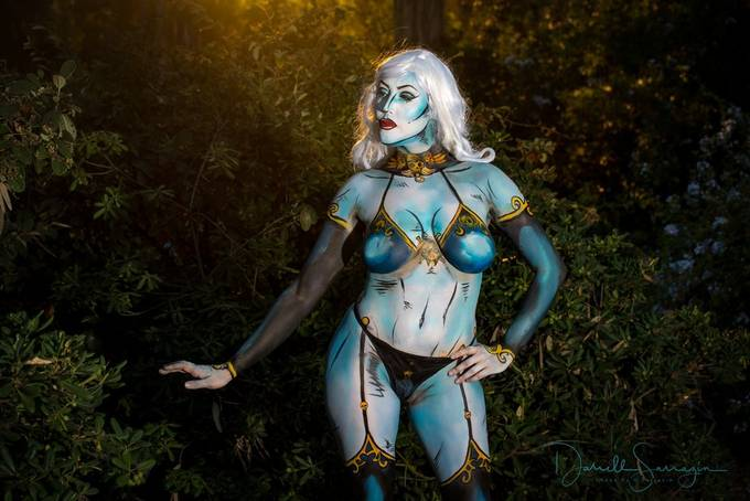 Body painted artist Brigitte Berlin Beetle. Self painted, model and painter.  Shot in a park at twilight.
