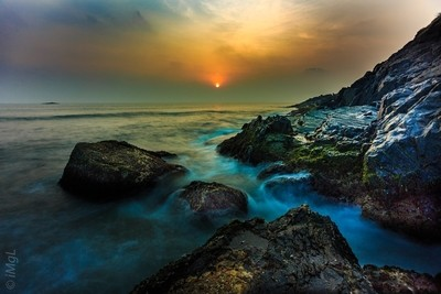Water, Rocks and Sunset