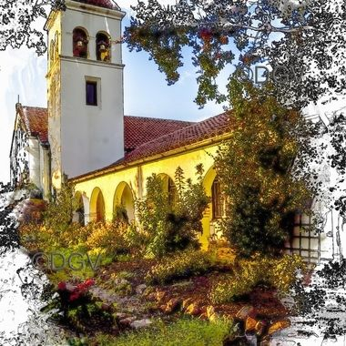 Mission style architecture, bell tower, arch, red clay tile roof