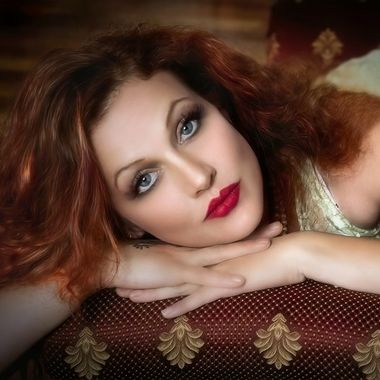 Using natural light from a big window to try and create some old time glamour.