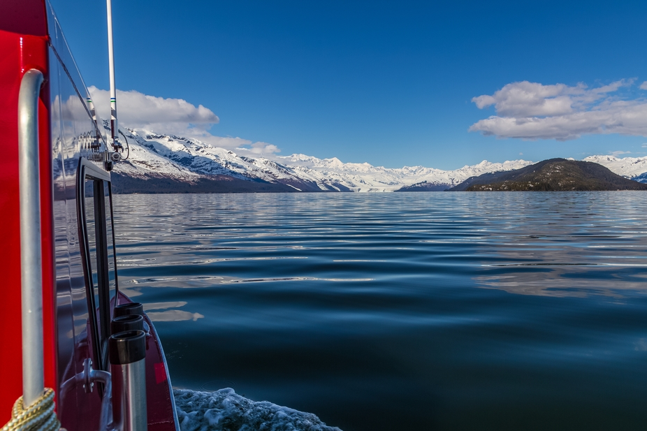 Spring boating in College Fjord on Prince William Sound can offer glass calm seas and clear skies.