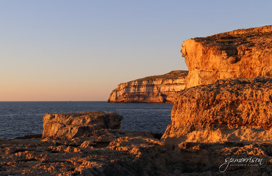 Sunset on the rocks of Dwerja Bay, Gozo. The film location for the wedding of Khal Drogo and Daen...