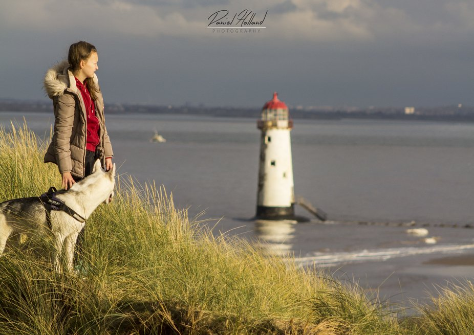 photo taken at Talacre, North Wales, UK  Image shows little sister with family dog. standing on t...