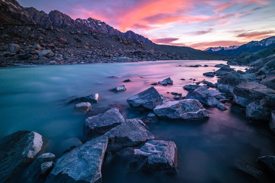 The colours of sunset shining on the glacial waters of the Tasman river. This place always seems ...