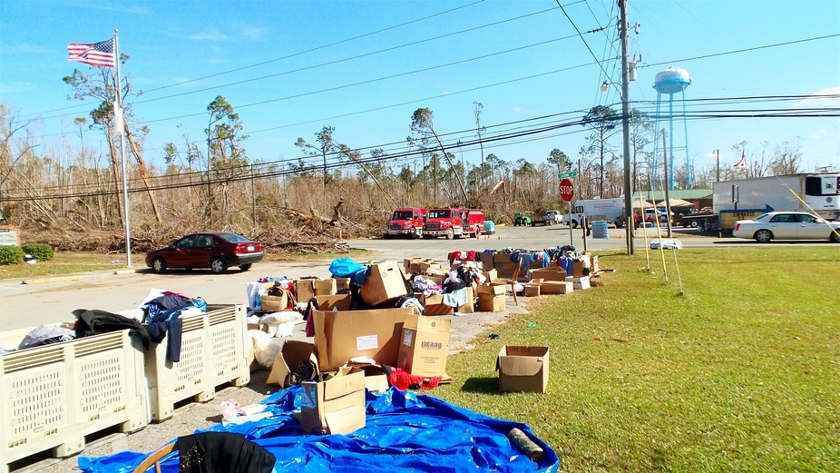 Recovery efforts of donated clothes in church parking lot after Hurricane Michael. This was ttake...