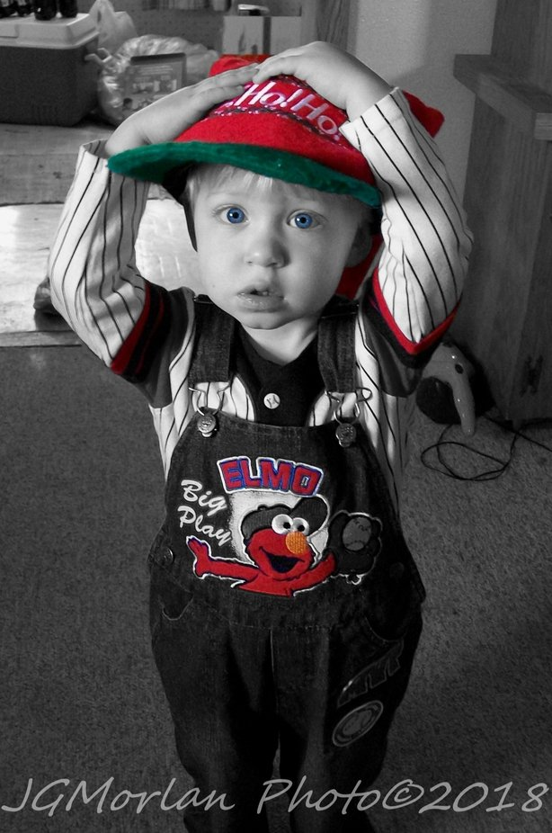I turned this photo into a black and white, then did some creative editing by adding color in key places: eyes, hat, parts of his shirt, and top of  his bib overalls.