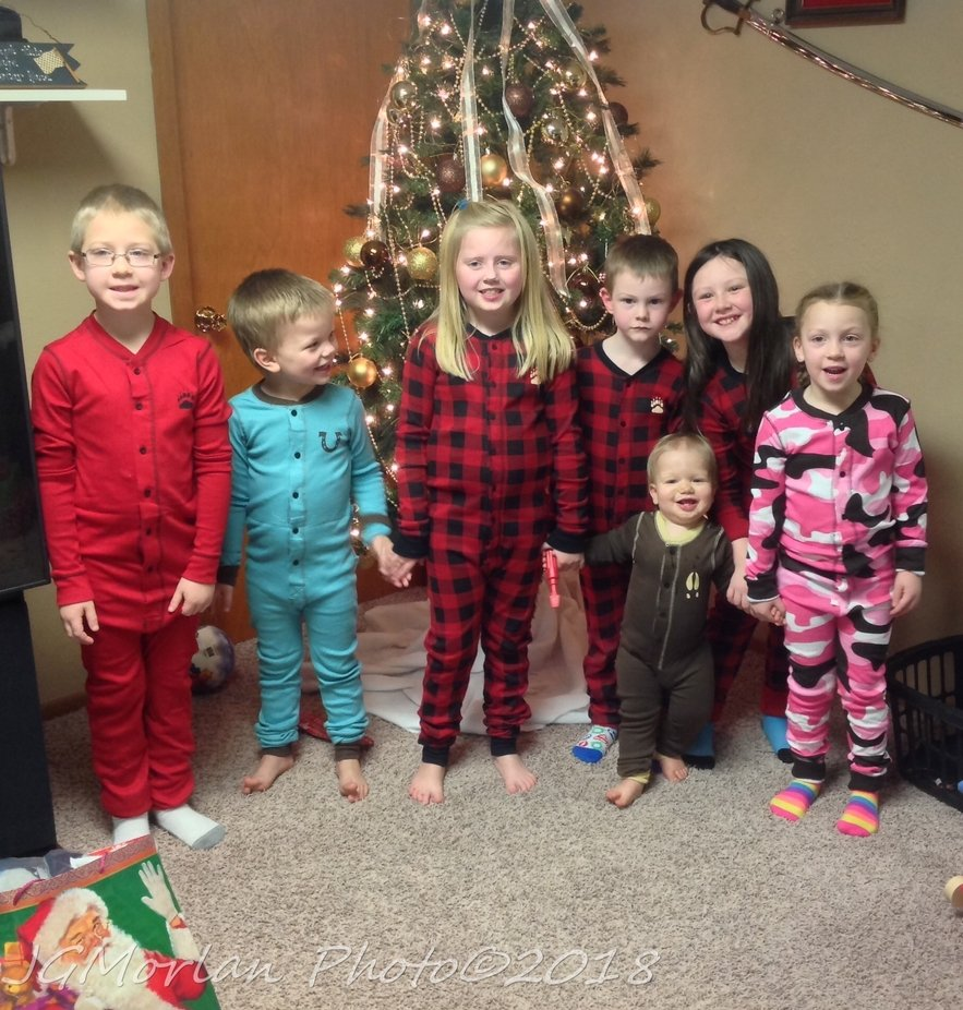 My sister-in-law gave all the little ones button up, back flap long john pajamas one year.  Here are my mother's 7 great-grandchildren in their outfits.  The 3 in matching ones are my brother and sister-in-law's grandchildren.   The 4 in mismatched ones are my grandchildren.  Photo was taken about 5 years ago.