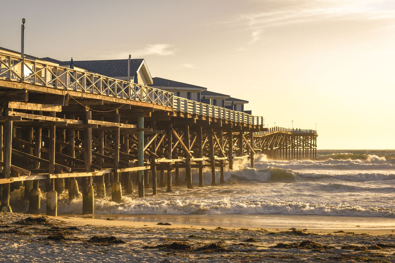 Old Pier at the pacific in San Diego is a meeting place for surfers and photographers